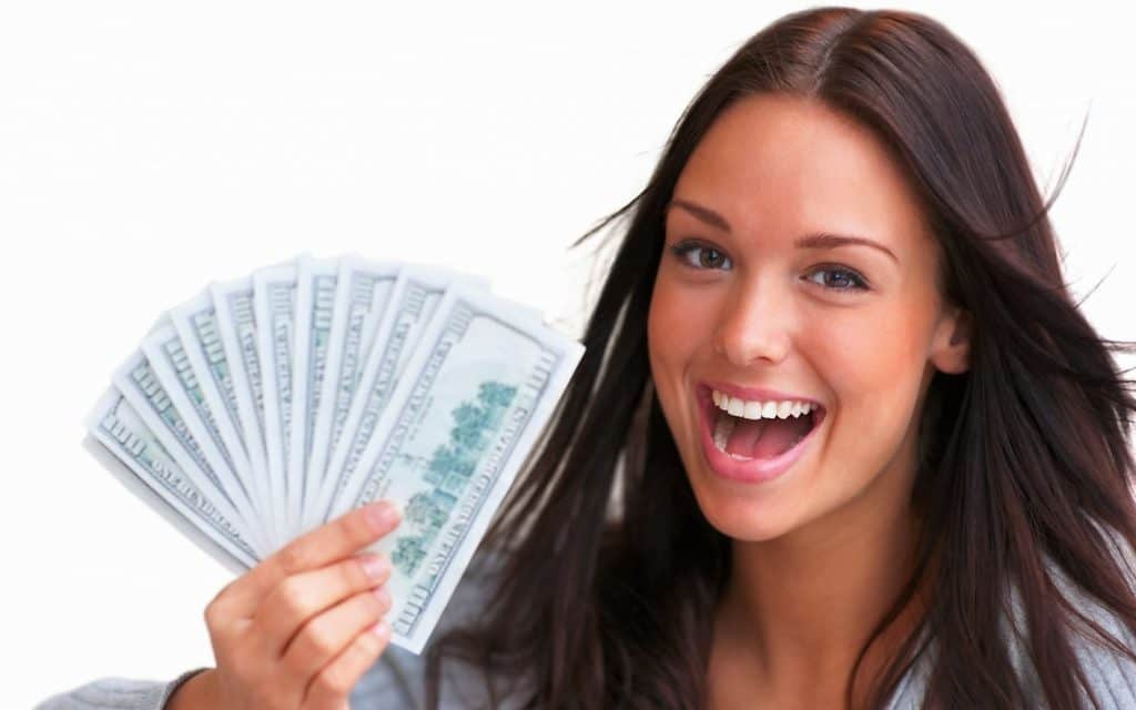 Easy Loans girl happy she has lots of cash in her hand