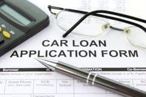 Car Finance Loans application form with pen glasses and calculator