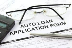 Logbook Loans for Cars on Finance auto loan application form on desk