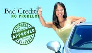 Guaranteed Car Finance girl leaning out of car window thumbs up
