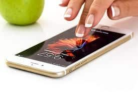 Mobile Contract Bad Credit lady with long nails using smart phone